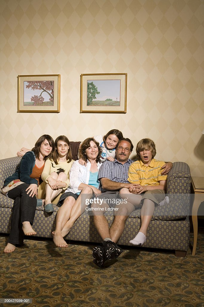 Family Sitting On Couch Portrait Stock Photo Getty Images
