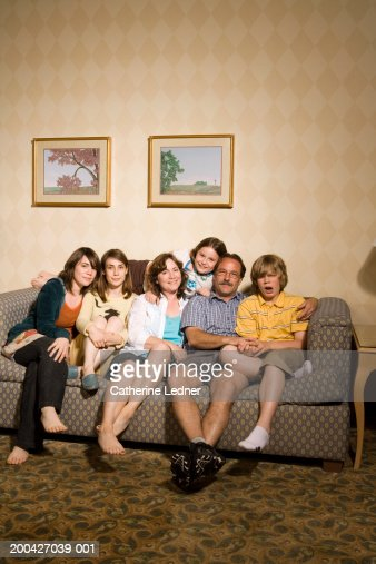 Family sitting on couch, portrait : Stock Photo