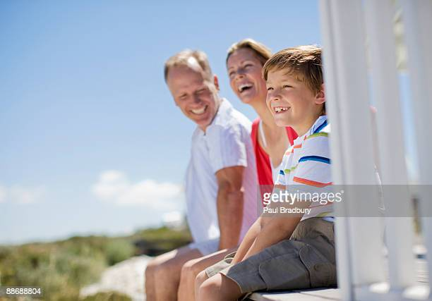 Family sitting on pier