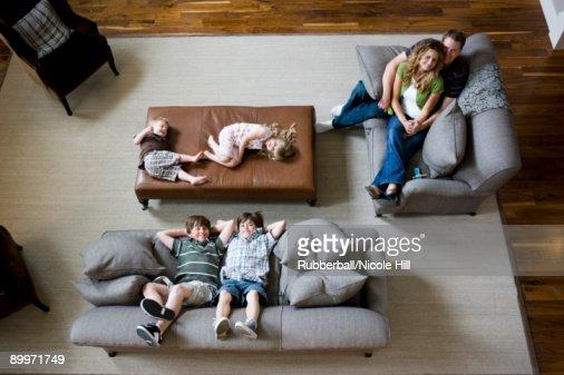 family sitting on sofa in living room