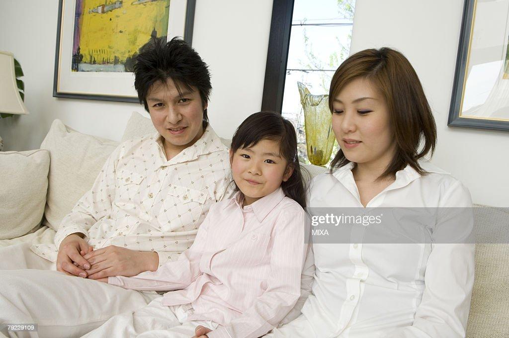 Family sitting on sofa : Stock Photo
