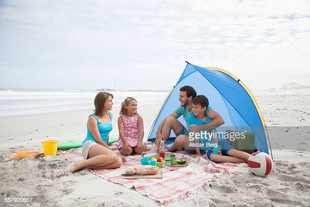 Family sitting together on beach