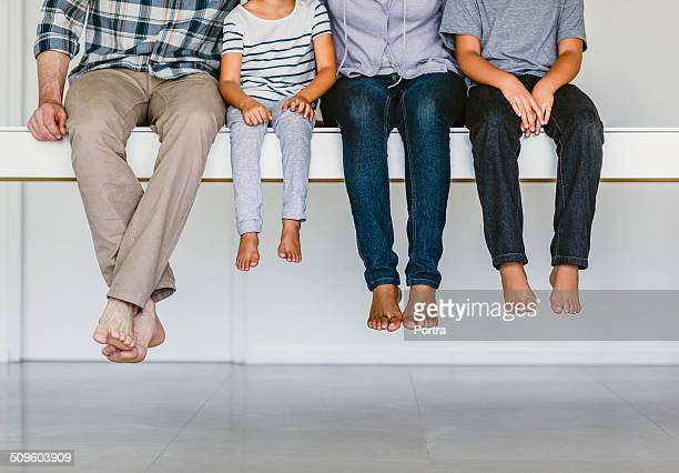 Family sitting together on bench