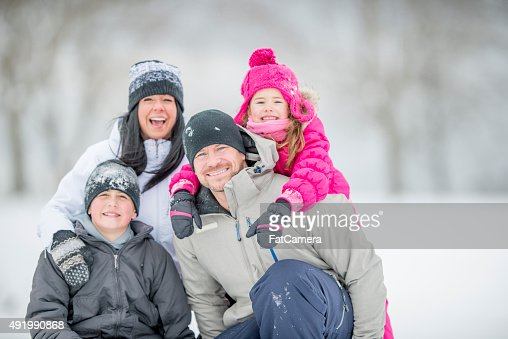 Family Sitting Together Out in the Snow