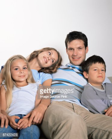 Family sitting together : Stock Photo