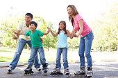 Family Skating In Park