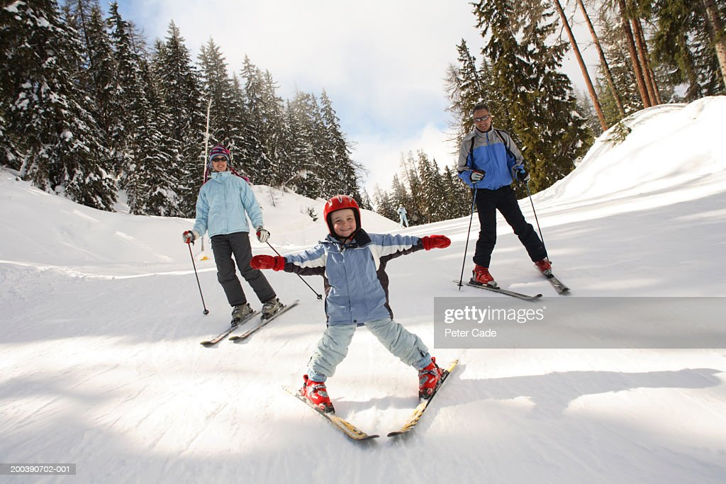 family skiing, son (4-6) in foreground, portrait : Stock Photo