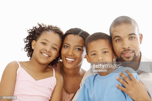 Family smiling against white background