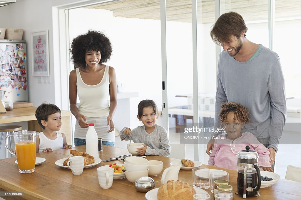 Family smiling at a breakfast table : Stock Photo