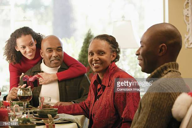 Family smiling at dining table