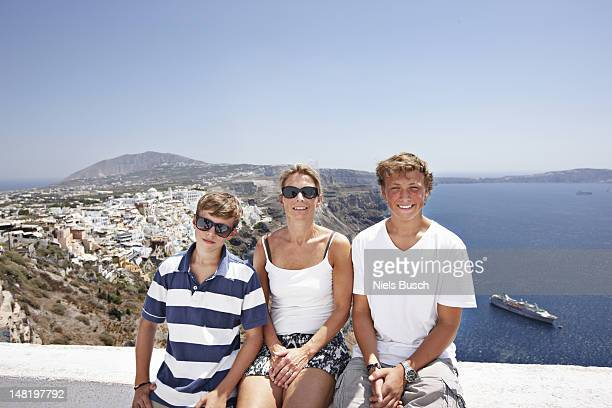 Family smiling on balcony together