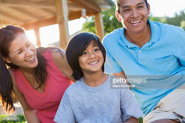 Family smiling outdoors