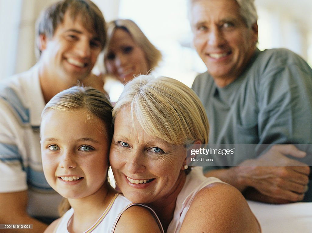 Family smiling, portrait (focus on grandmother and girl (7-9)) : Stock Photo