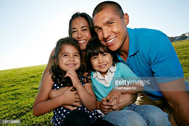 Family smiling together in field