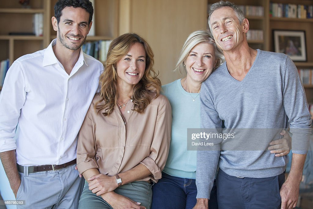 Family smiling together in living room : Stock Photo