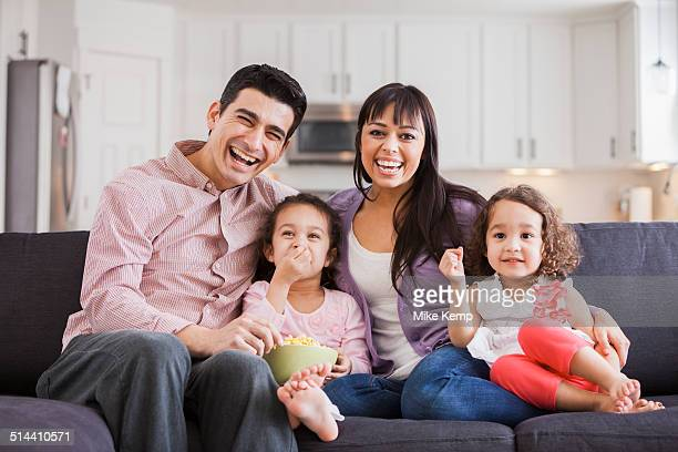Family smiling together on sofa