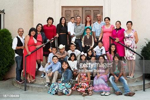 Family smiling together outside church