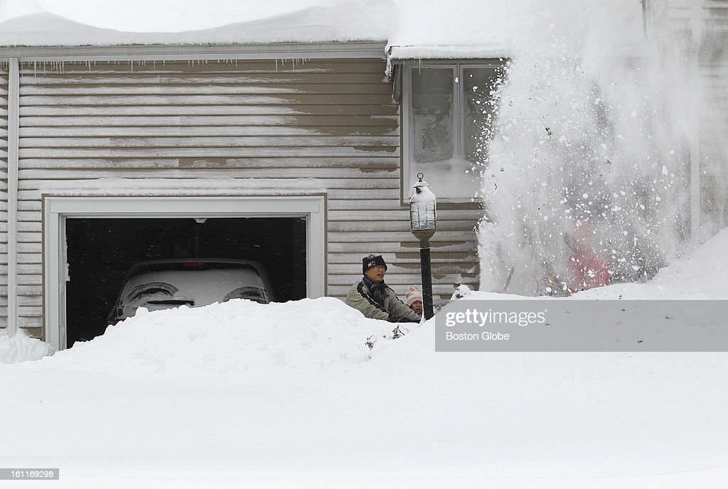 A family snow blows and digs out on Great Plain Ave in Needham.