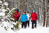 Family snowshoes in snow in Canada during the winterFamily snowshoes in snow in Canada during the winter
