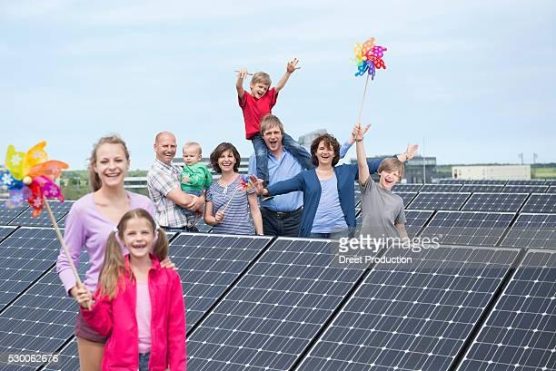 Family solar energy windmill smiling future