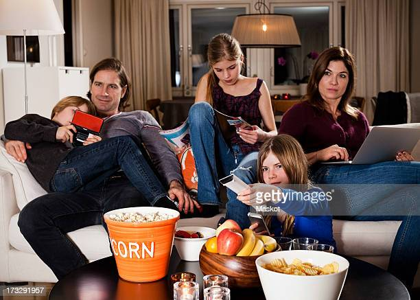 Family spending leisure time in living room
