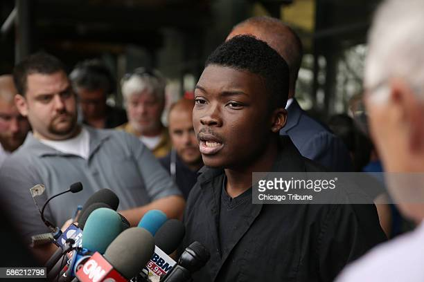 Family spokesman and activist Ja'Mal Green center and attorney Michael Oppenheimer speak during a press conference after viewing the the dashcam and...