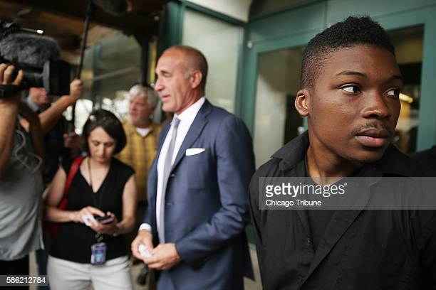 Family spokesman and activist Ja'Mal Green right and attorney Michael Oppenheimer speak oneonone to journalists following a press conference after...