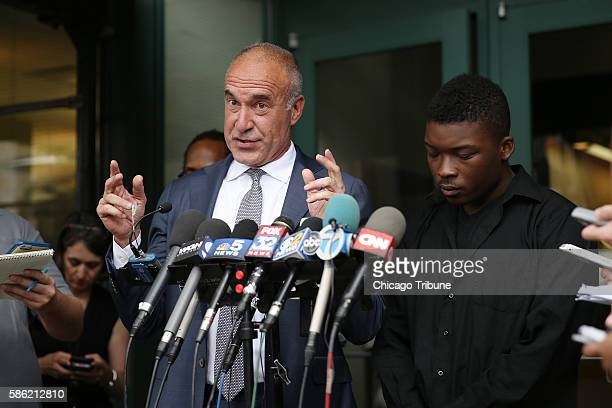 Family spokesman and activist Ja'Mal Green right and attorney Michael Oppenheimer speak during a press conference after viewing the the dashcam and...
