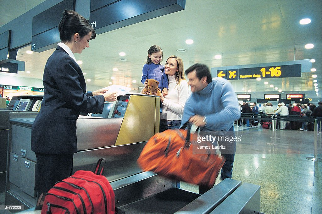 Family Standing at the Airport Check In