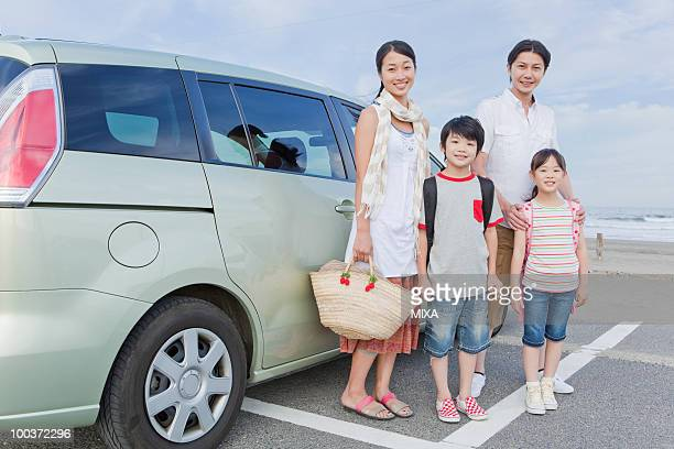 Family Standing in front of a Car
