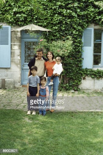 family standing in front of house portrait stock photo getty images. Black Bedroom Furniture Sets. Home Design Ideas