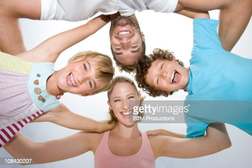 Family standing in huddle, Portrait : Stock Photo