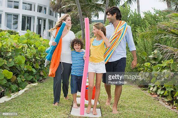 Family standing in the garden of a tourist resort