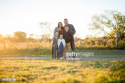 Family Standing in Their Front Yard