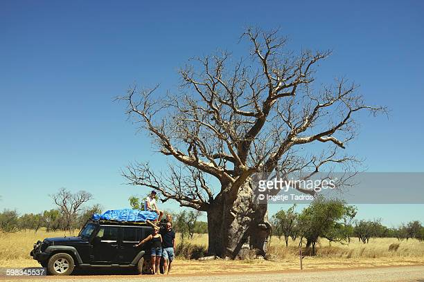 Family standing next to car next to a huge Boab