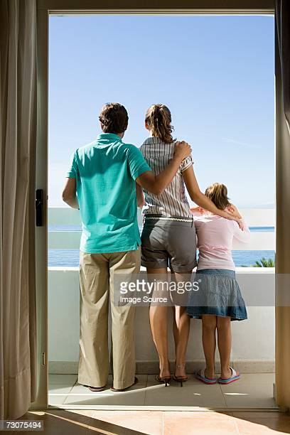 Family standing on a balcony