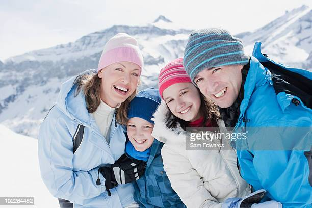 Family standing on mountain top