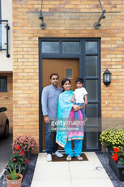 Family standing outside their home in UK