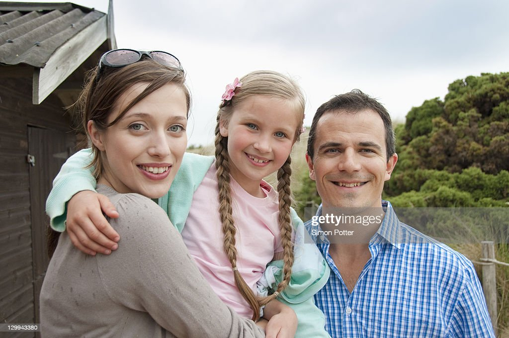 Family standing together outdoors : Stock Photo