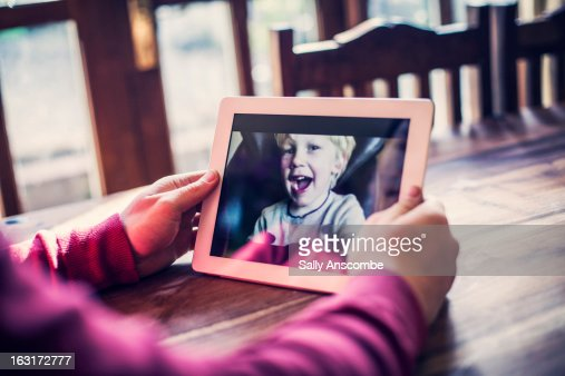 Family staying connected online : Stock Photo