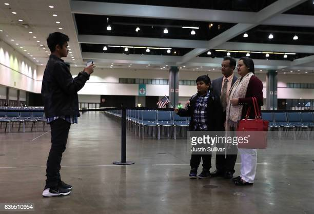 A family stops to take a picture at the conclustion of a naturalization ceremony held by US Citizenship and Immigration Services at the Los Angeles...