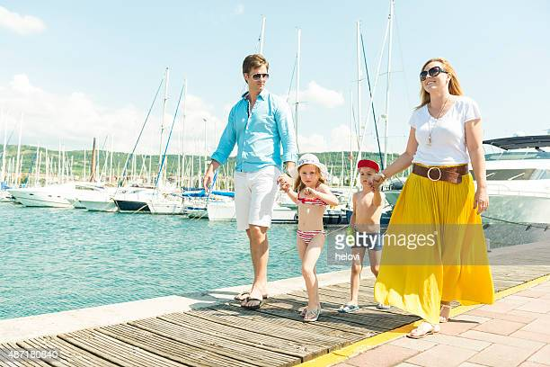 Family strolling on a pier