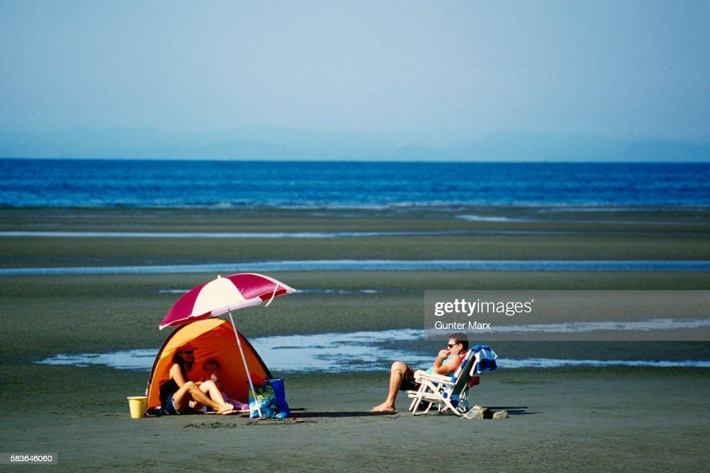 Family sunbathing on Beach, White Rock, BC, Canada
