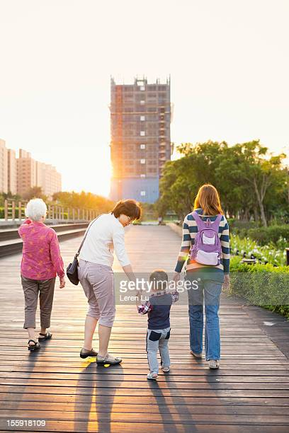 Family take a walk in park