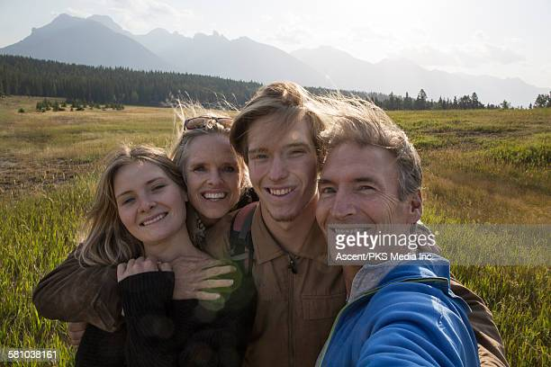 Family take selfie in mountain meadow
