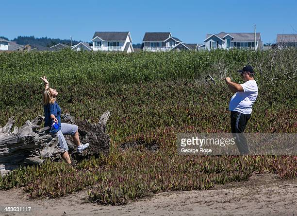 A family takes a picture near Glass Beach on September 6 in Fort Bragg California Located three hours north of San Francisco Mendocino County has a...