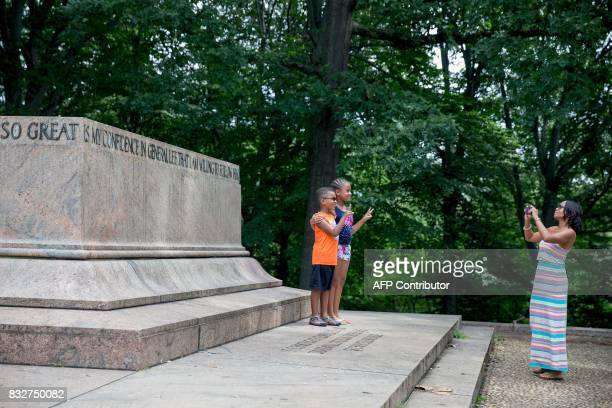 A family takes photos at the Robert E Lee and Thomas J 'Stonewall' Jackson monument base in Wyman Park Dell in Baltimore Maryland after it was...