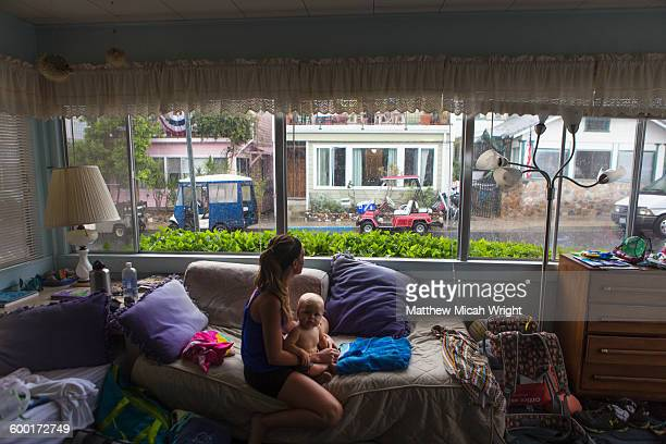 A family takes refuge inside during a storm.