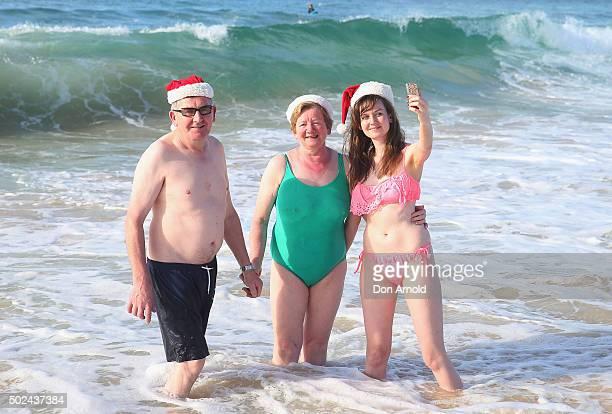A family takes selfies at Bondi Beach on December 25 2015 in Sydney Australia Bondi Beach is a popular tourist destination on Christmas Day