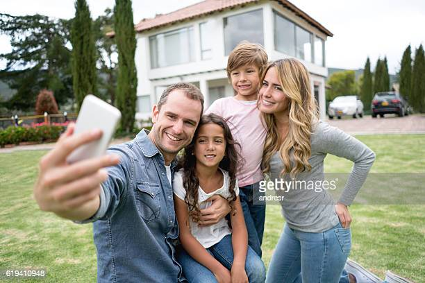 Family taking a selfie at the park